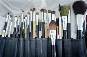 Old makeup brushes in holde