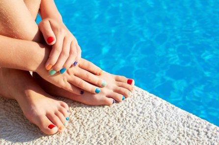 Vacation idea. Woman feet closeup. Beautiful pedicure.