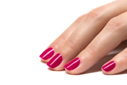 Woman hands with manicured pink nails